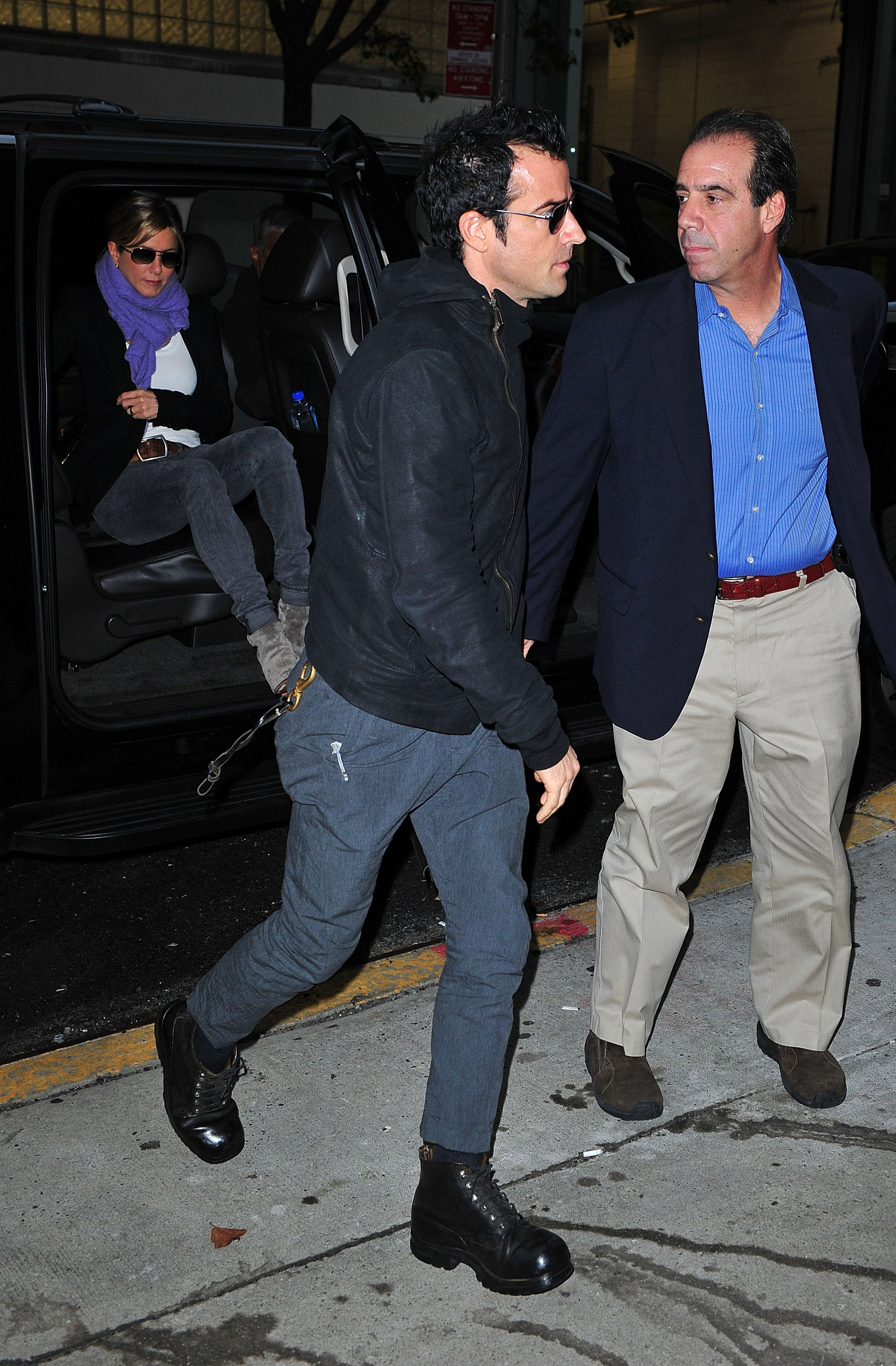 Jennifer Aniston followed Justin Theroux out of their car.