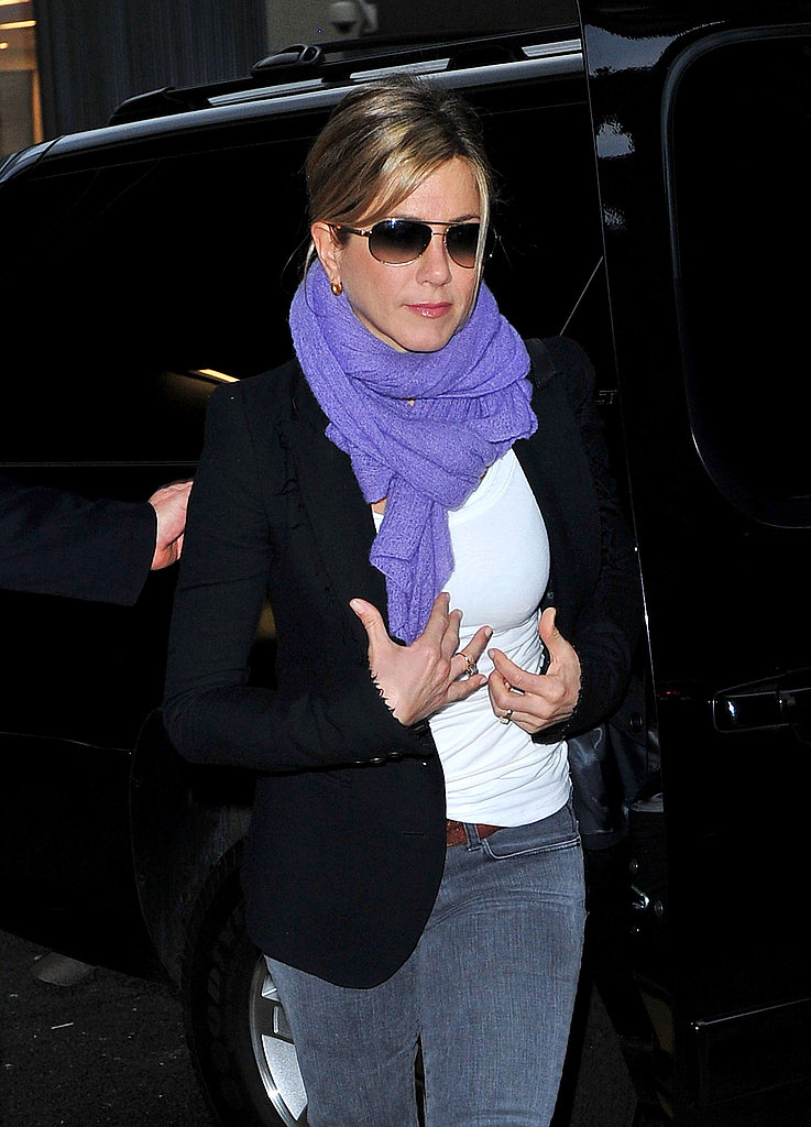 Jennifer Aniston made amped up her basics with a purple scarf.
