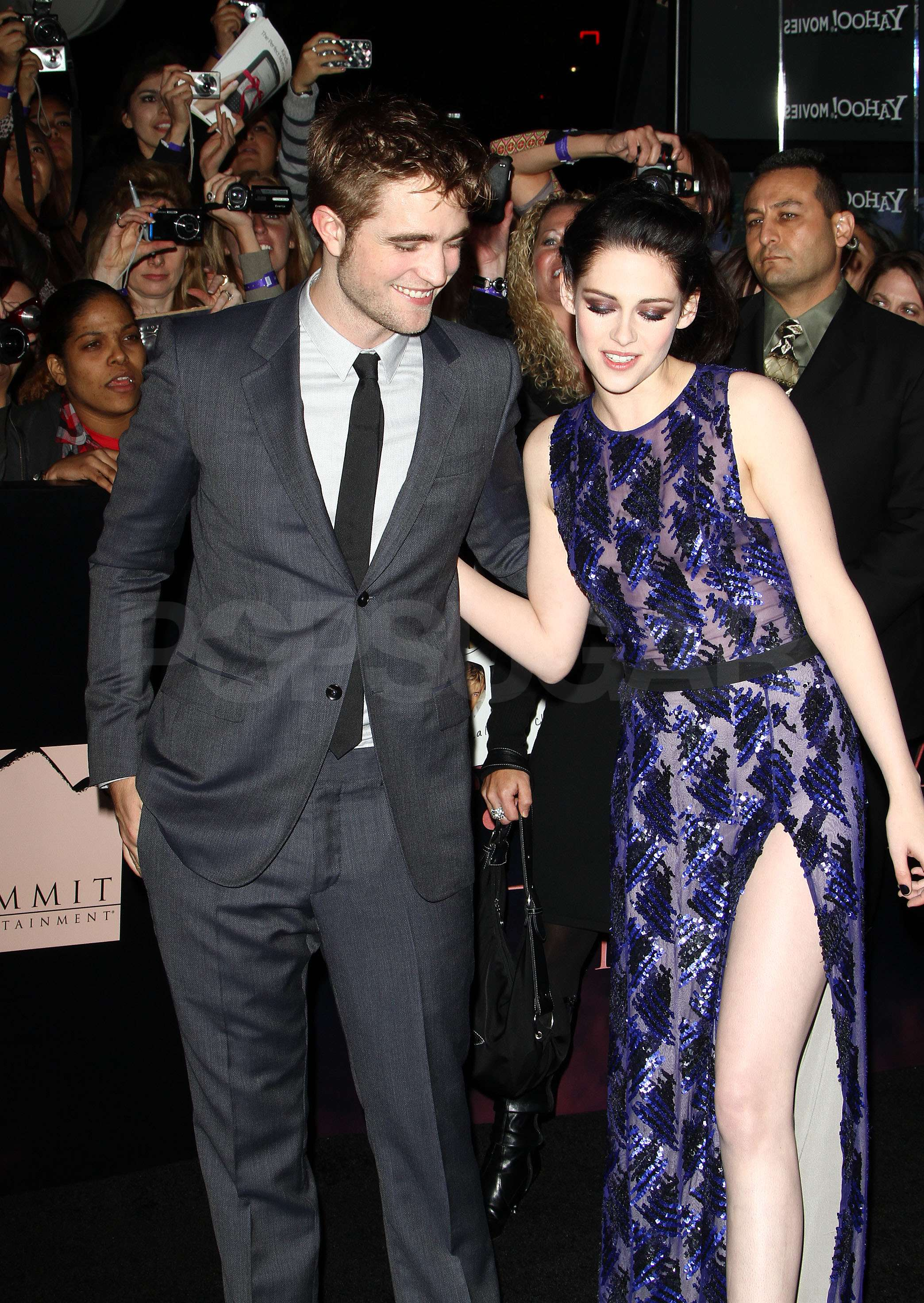 Kristen Stewart had Robert Pattinson for support as she posed in heels at the Breaking Dawn premiere.
