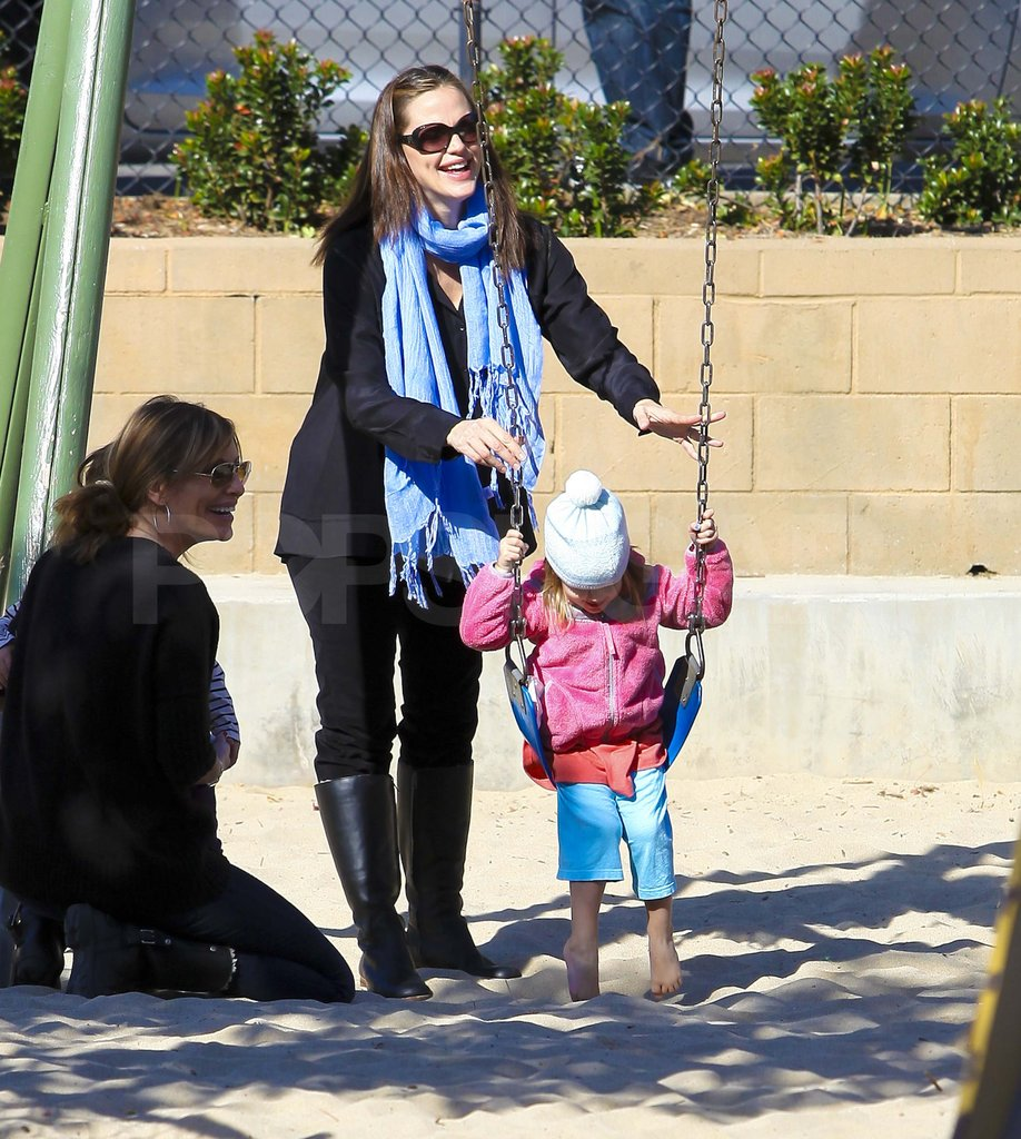 Seraphina Affleck on the swings.