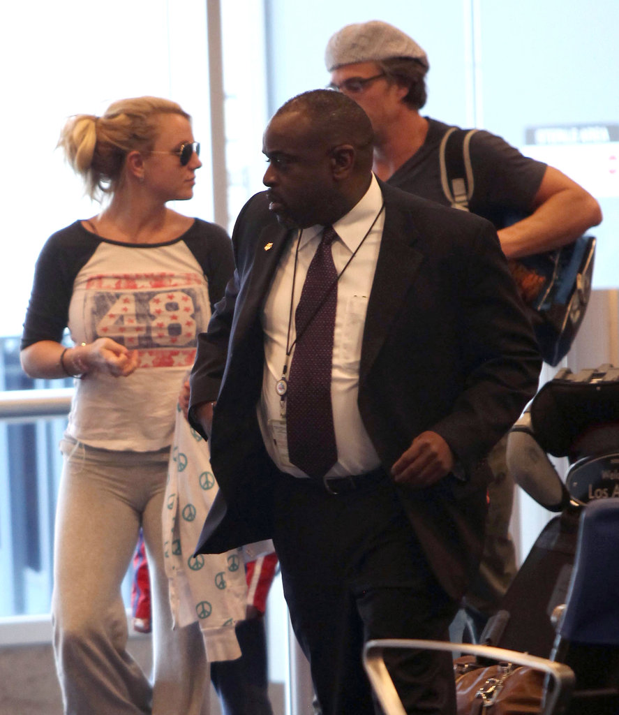 Britney and her Boys Touch Down at LAX Following Femme Fatale