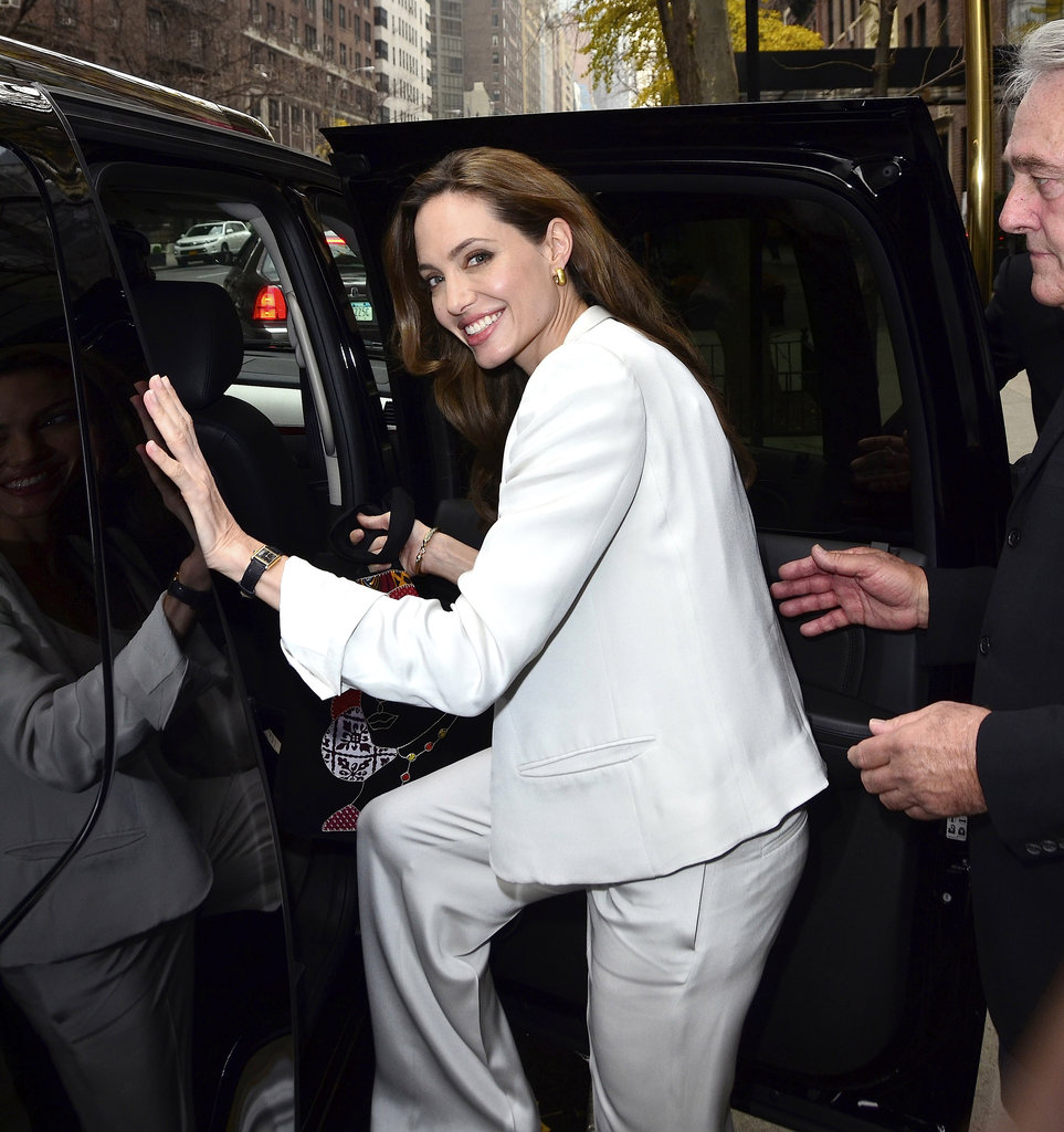 Angelina Jolie smiled to fans and photographers before leaving the studio.