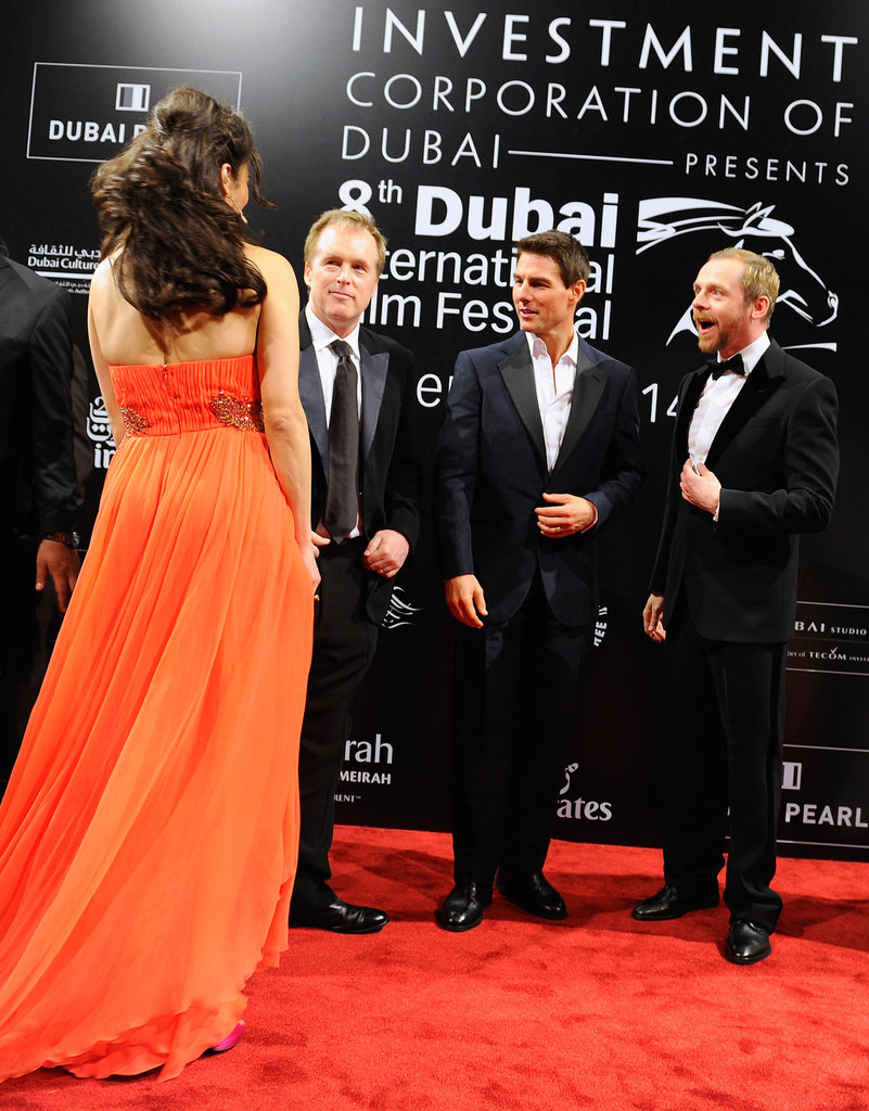 Brad Bird, Tom Cruise, and Simon Pegg chatted while Paula Patton gave a peek at the back of her dress.