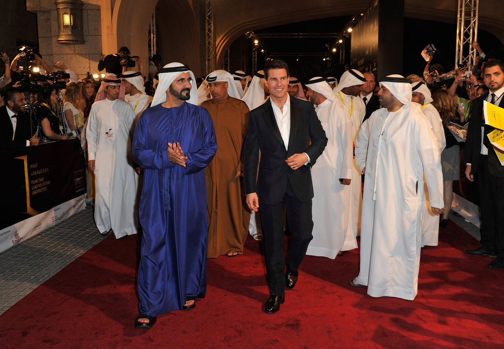 Tom Cruise led a parade of men down the red carpet in Dubai.