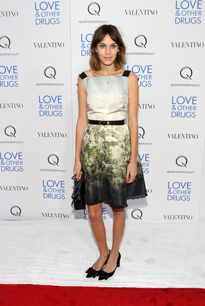 Her soft, printed Valentino and Louis Vuitton heels make a perfect pair for evening.