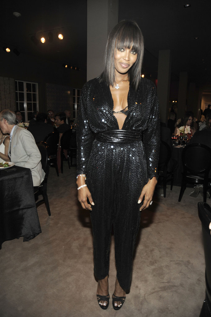 Naomi Campbell suits up in a sexy play on sequins, with a decolletage-baring neckline.