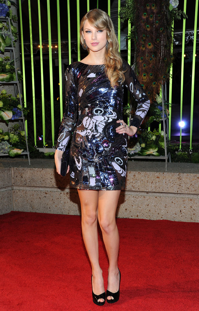 Taylor Swift goes funky in a multicolored Emilio Pucci sequin dress.