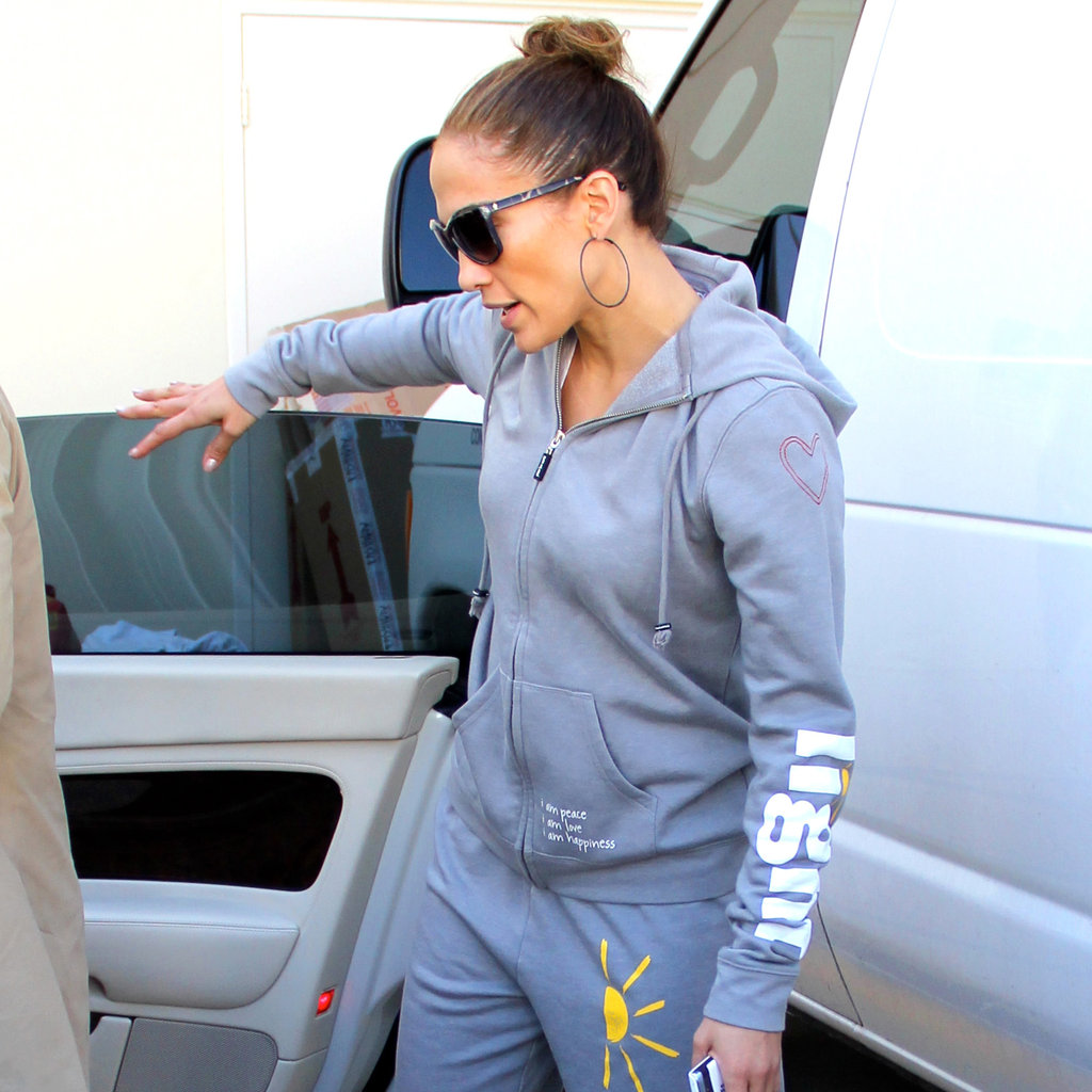 Jennifer Lopez held open the car door after shopping at the LA Valentino boutique in sweats.