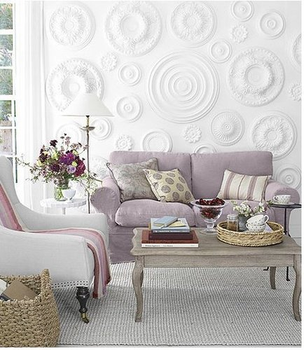 Country Living came up with the brilliant idea to use ceiling medallions as a wall treatment.  Source: Country Living Magazine