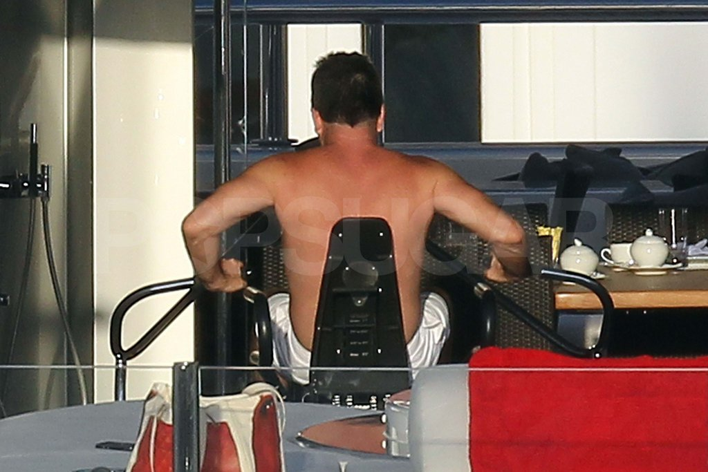 Simon Cowell working out shirtless.