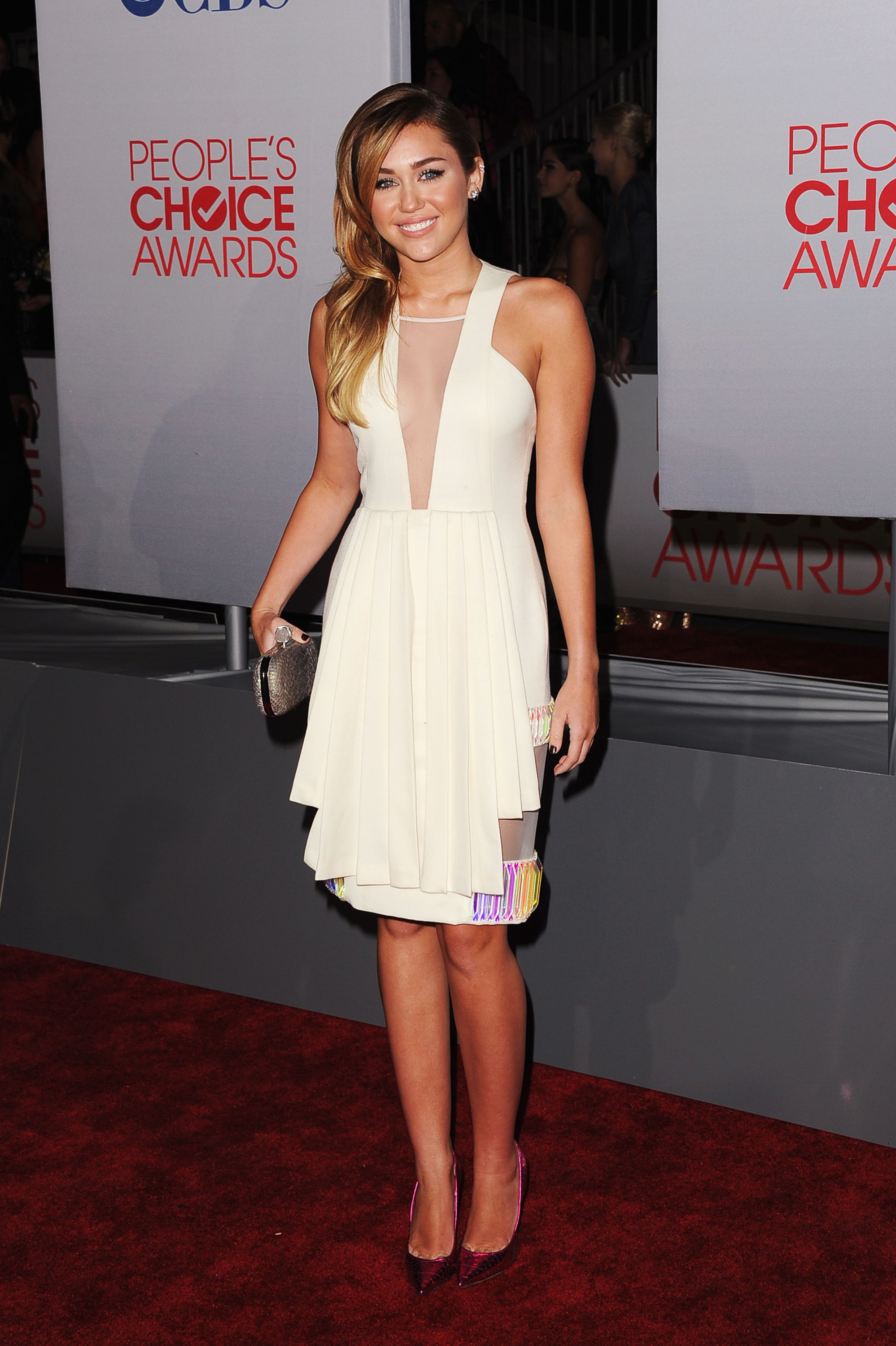 Miley Cyrus in a cream David Koma dress.