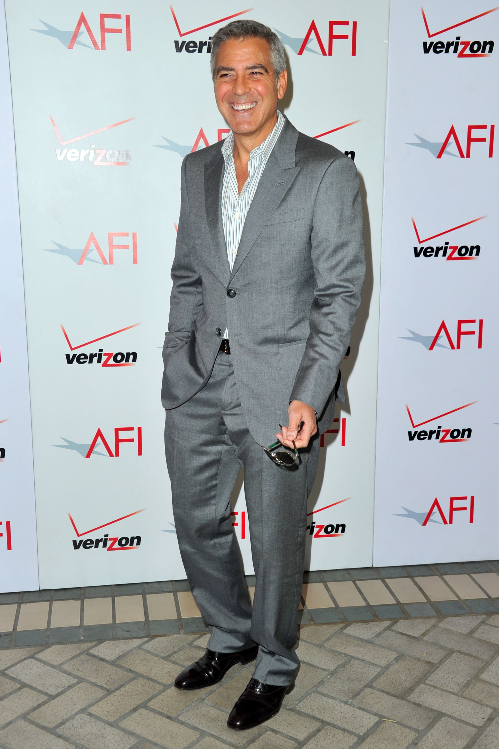 George clooney in a gray suit george leo claire rooney and more