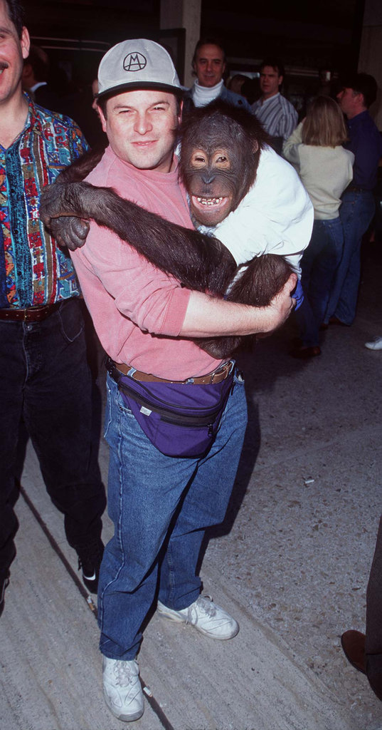 Jason Alexander earns a hug from his primate costar at the 1996 premiere for Dunston Checks In.