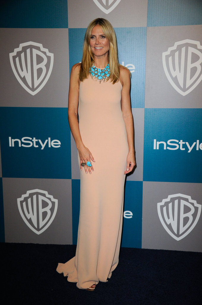 Heidi Klum smiled on her way into InStyle's Golden Globes afterparty.