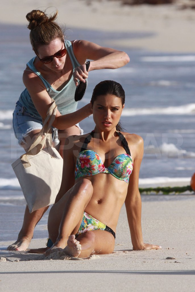 Adriana Lima had hair tended to.