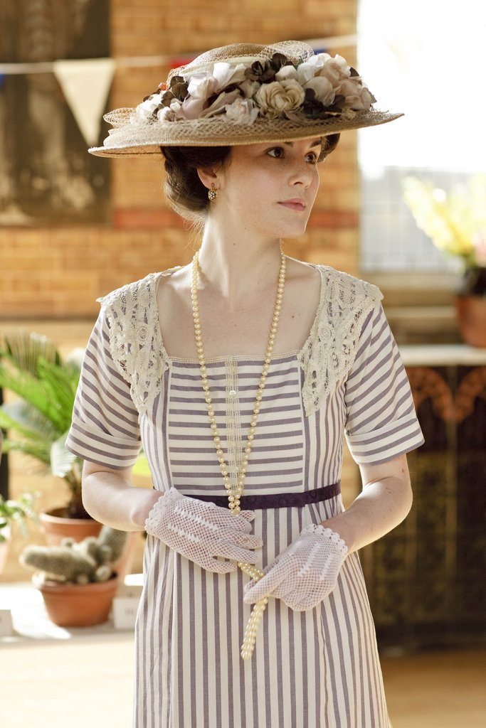 Hats, usually topped with flowers or feathers, were de rigueur during the Edwardian era.