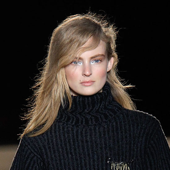 """Next, to get that vintage '80s asymmetry, tuck one side under the hair  and pin it so that it's hidden beneath. Tip: for even more punk cred,  Pecis recommends """"overdrying the hair so that it has more lightness and  more static electricity."""""""