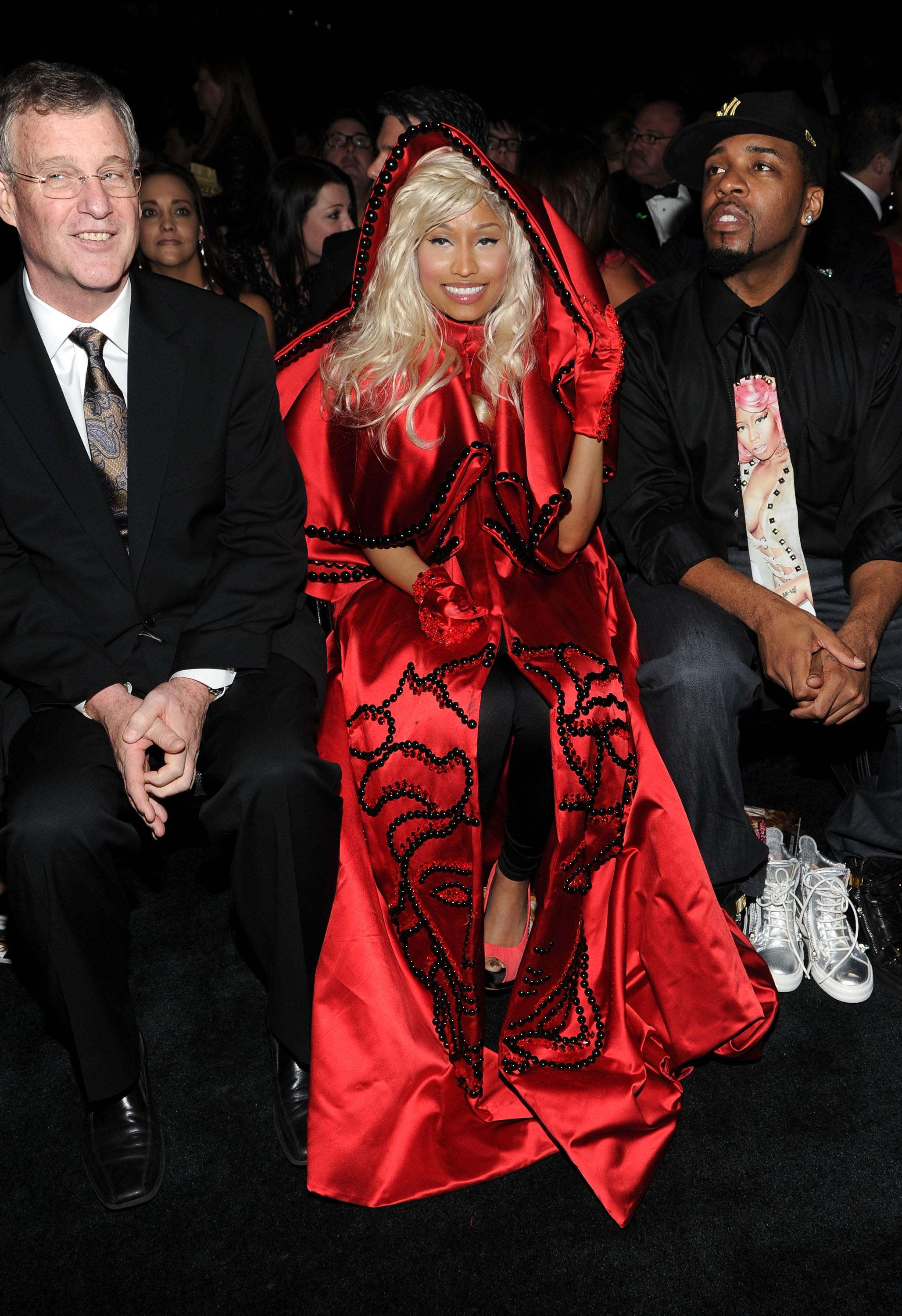 Nicki Minaj kept warm in her red cape.
