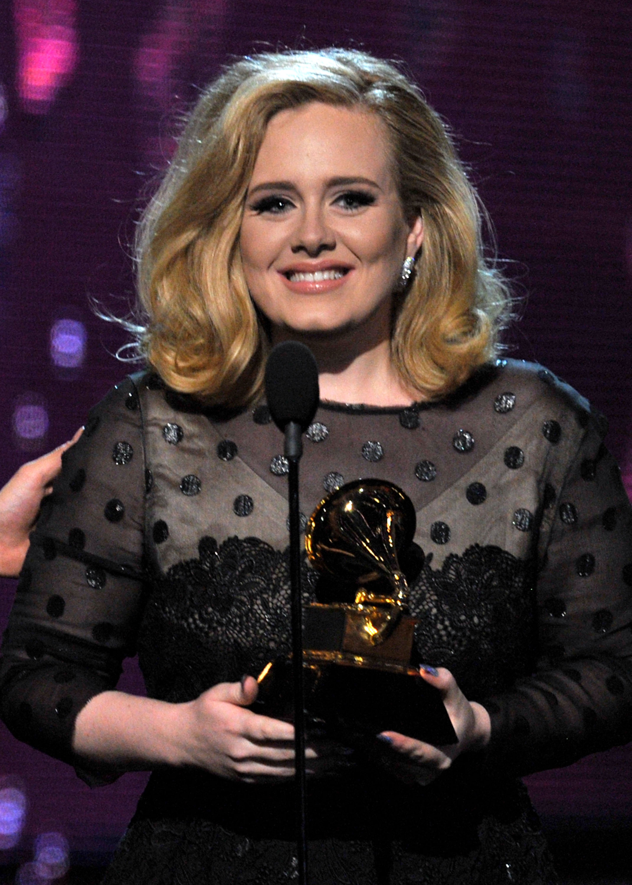 Adele accepted a Grammy honor.