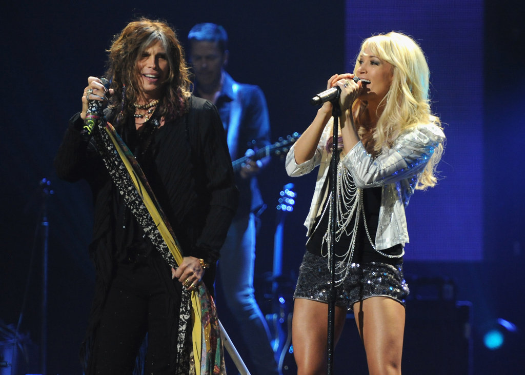 Steven Tyler checked out Carrie Underwood as they performed together during the Pepsi Super Bowl Fan Jam in 2012.