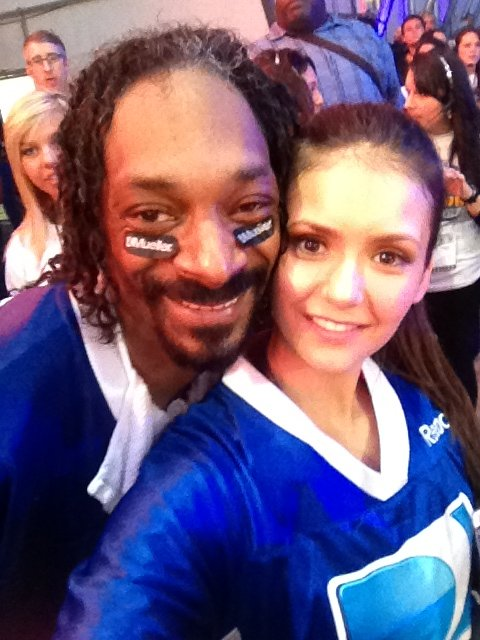 Nina Dobrev shared a snap with Snoop Dogg at DirecTV's Super Bowl party in February. Source: Twitter User ninadobrev