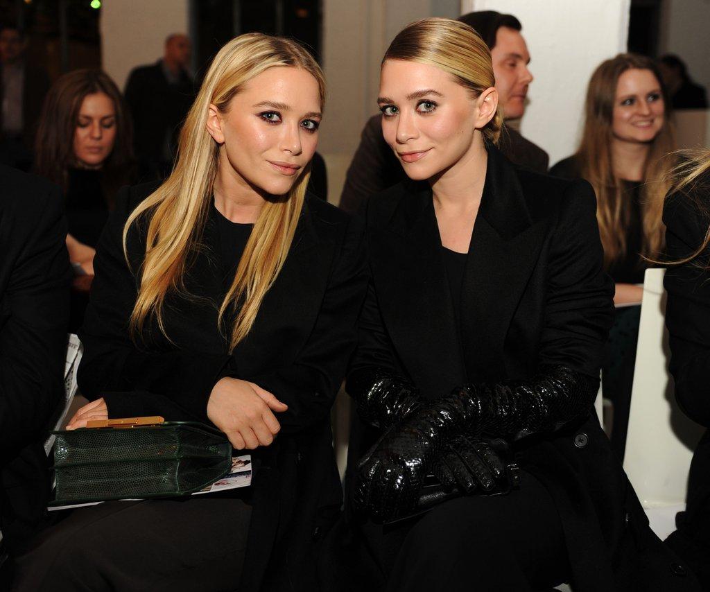 Mary-Kate Olsen and Ashley Olsen sitting front row at NY Fashion Week.  worldredeye.com