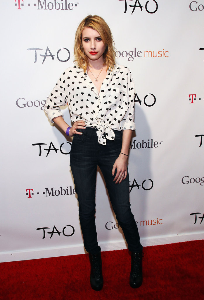 Emma's obsession with hearts continued at Sundance in January. The actress wore an Asos blouse with high-waist skinny jeans and bold red lips. Though her top is sold out, get something similar, then tie it for sassy flair like Emma did.       Button Front Tops by Forever 21Boots by Kelsi Dagger