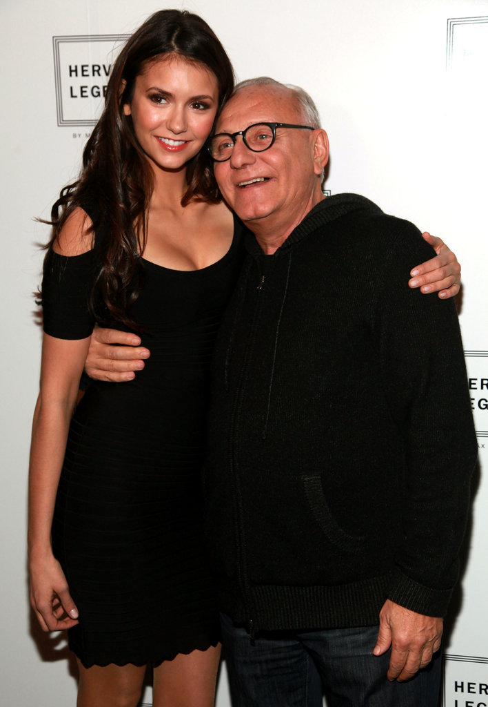 Nina Dobrev posed with designer Max Azria at his Herve Leger show.