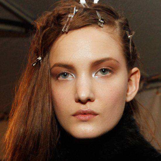 """Bumble and bumble's James Pecis opted for an """"'80s punk rock, asymmetric  look"""" that was """"an evolution of an Edun girl from previous seasons,"""" he  explained. To get the style, start by spritzing on the brand's Surf  Spray to build up texture in the hair. Then, use hair clips in the front and crown area to give a subtle lift  to the look. Add some Thickening Spray for even more texture, and remove  the pins once the hair is set."""
