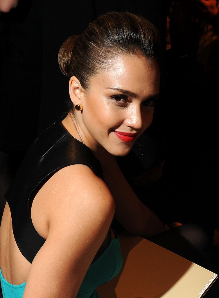 Jessica Alba flashed a bright smile wearing NARS's Heat Wave lip color.