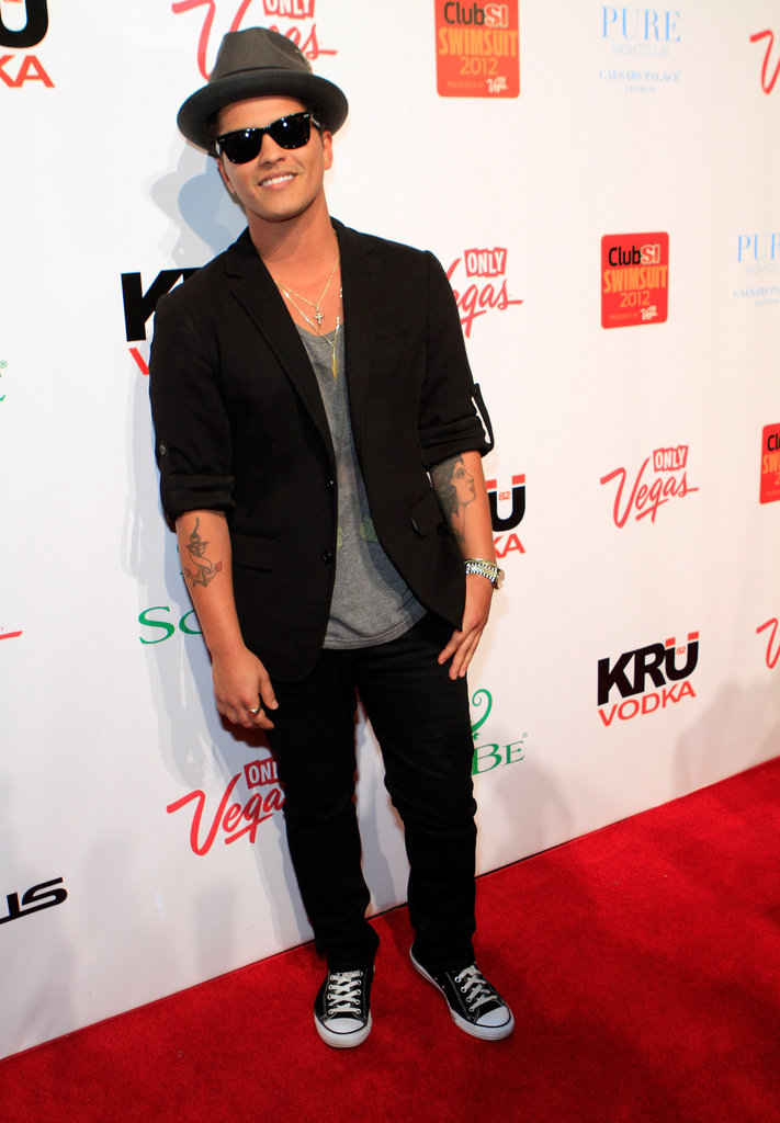Bruno Mars hit the red carpet before performing at the party.