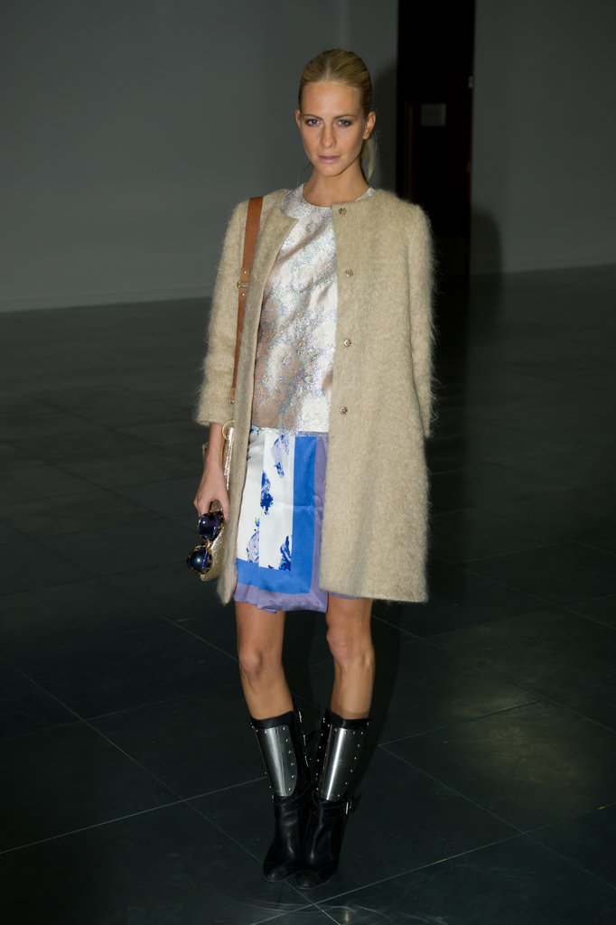 Poppy Delevingne showed off her style prowess during NYFW in a floral wrap skirt, metallic top, and cozy sweater coat.   More Philosophy di Alberta Ferretti...