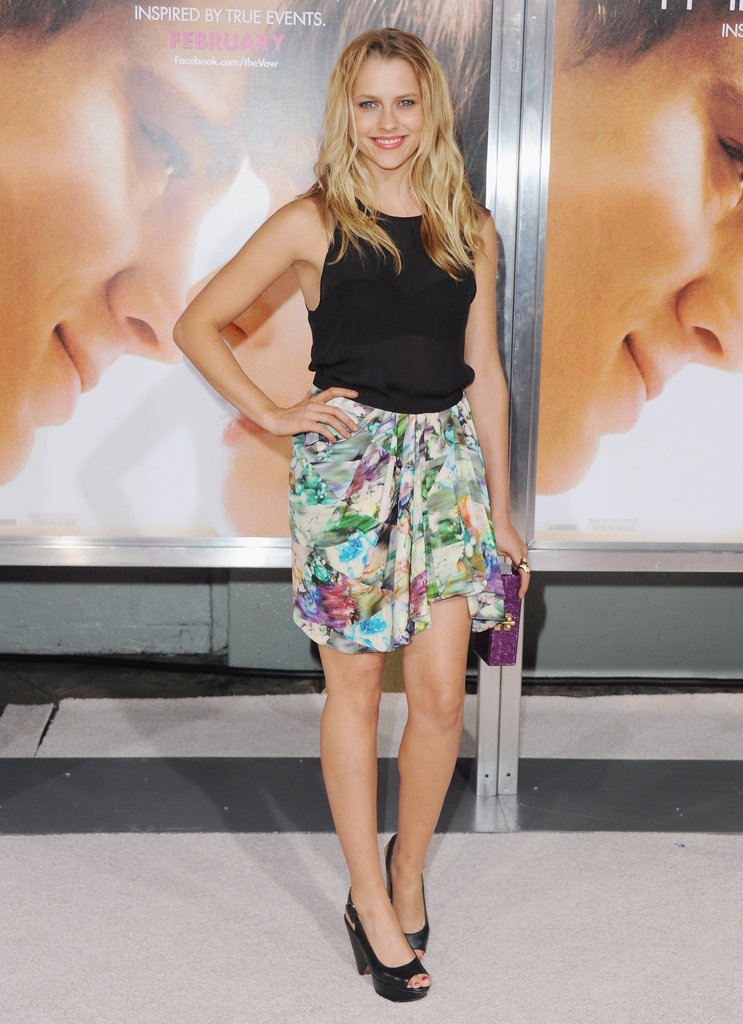 Teresa Palmer paired a sheer top with a floral printed Lisa Ho skirt at The Vow premiere.   More Gianvito Rossi...