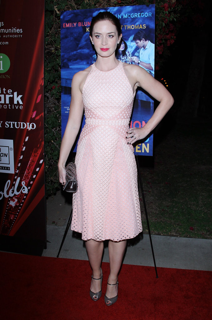 Emily Blunt's Marios Schwab dress boasts the classically feminine shape, albeit with modern perforated detailing.