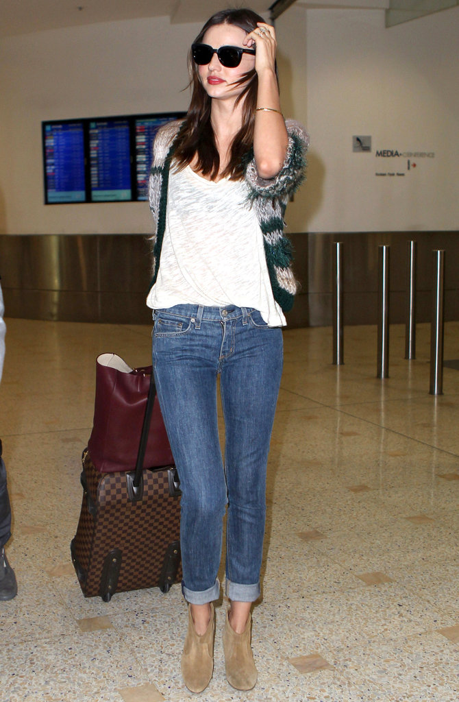 Proof that this bag goes with anything? Miranda toted her Celine to the airport as the perfect pulled-together accent piece (and roomy travel companion) for her dressed-down travel style.