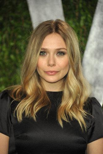 Elizabeth Olsen arrives at Vanity Fair party.