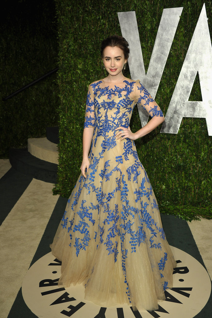 Lily Collins in a violet-blue and nude Monique Lhuillier tulle gown.
