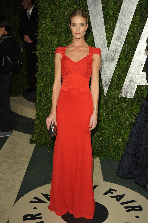 Rosie Huntington-Whiteley in a red cap-sleeve Antonio Berardi gown.
