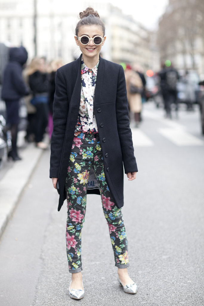 A black coat anchors floral on floral.