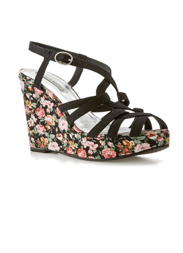 We love the idea of pairing these floral print wedge sandals with denim cutoffs and a floaty tunic for your next Summer music festival.  Lovely People Marianne Floral Wedge Sandals ($50)