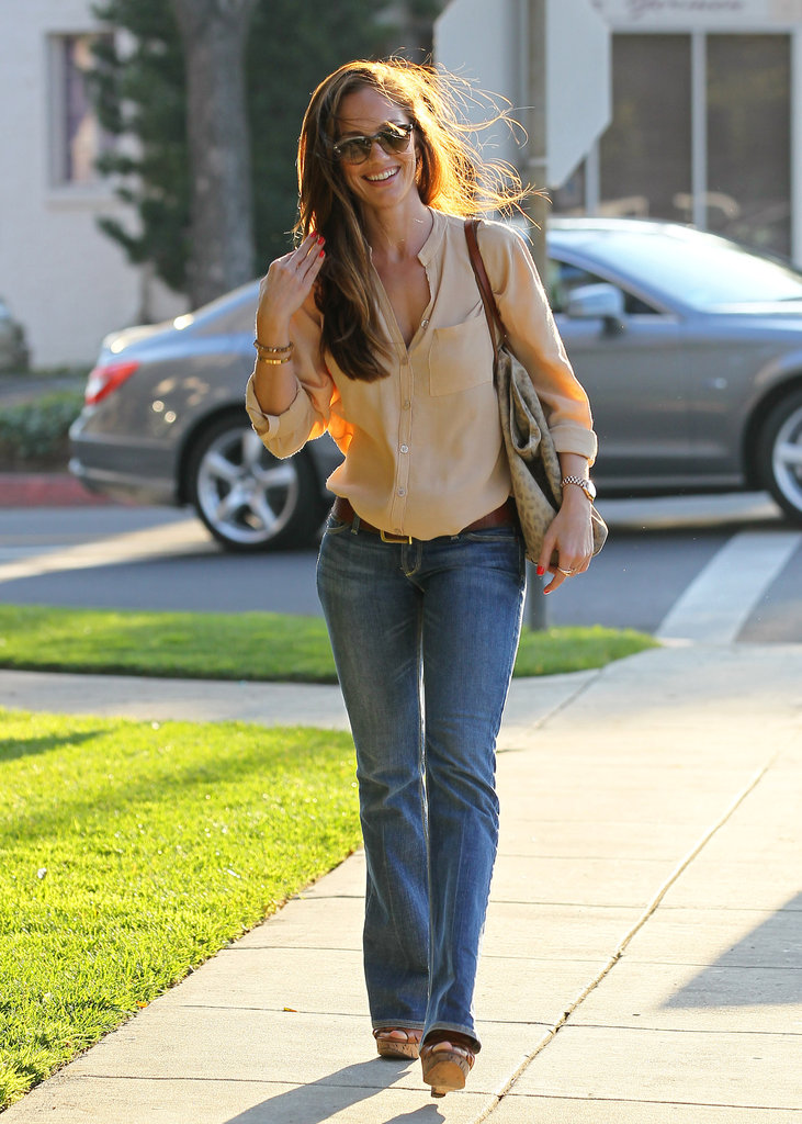 Consider this the Spring uniform — Minka Kelly outfitted a breezy button-down and staple denim.