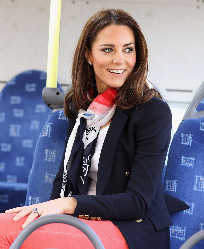 Kate Middleton wearing red pants and a blazer.