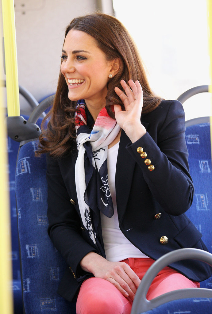 Kate Middleton in red pants and a blazer.