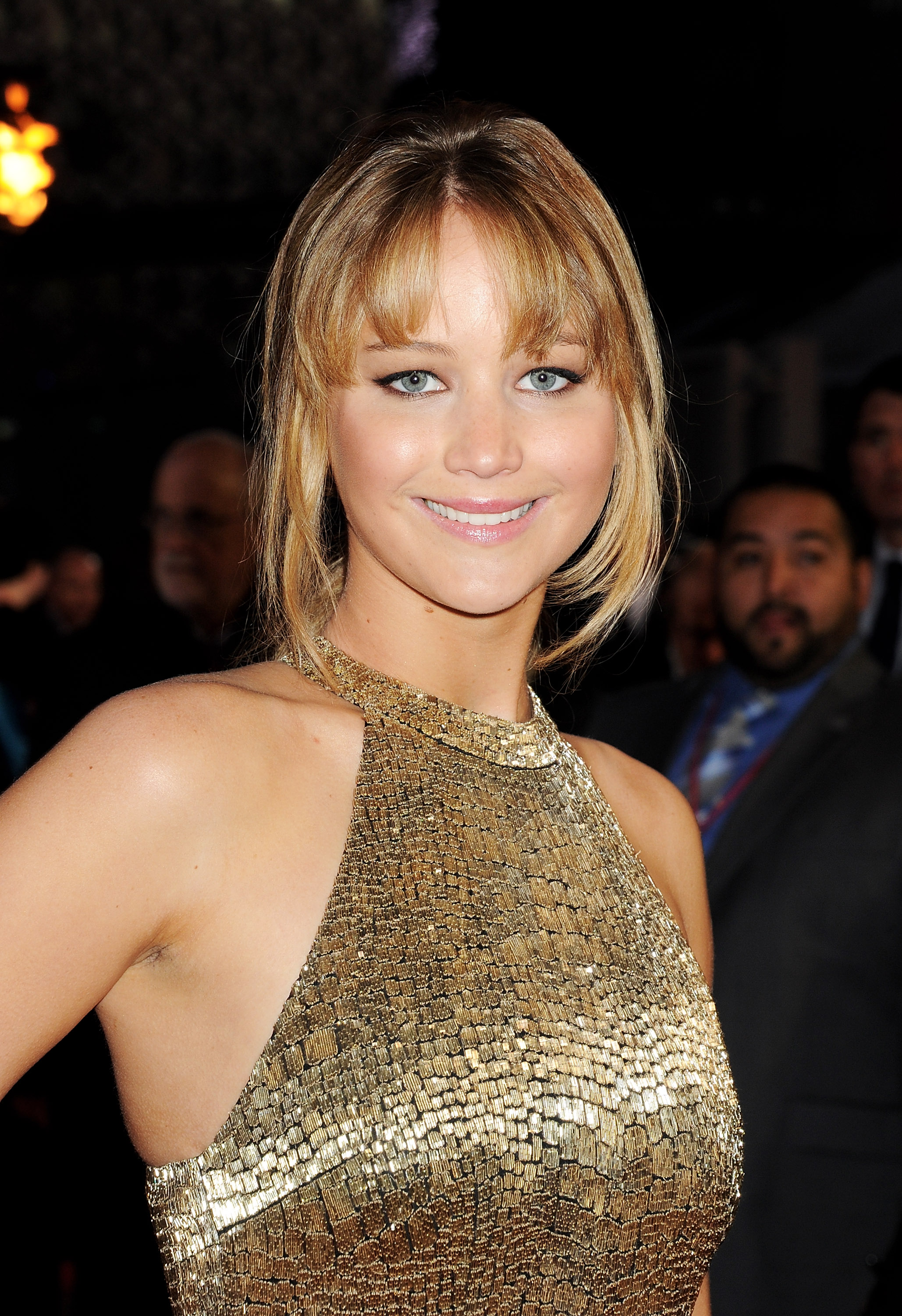 Jennifer opted for a more neutral makeup palette this time with nude lips, a stroke of black eyeliner, and a tousled updo.