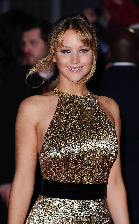 Jennifer Lawrence's custom Ralph Lauren gown featured a black ribbon belt detailing, creating a beautiful hourglass silhouette.