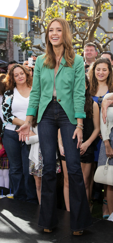 Jessica Alba topped high-waisted flares with a bright blazer.