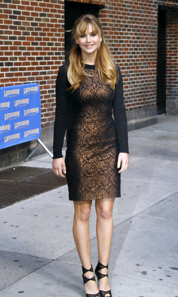 On her way out of the show, Jennifer slipped into this bronzed Prabal Gurung sheath.