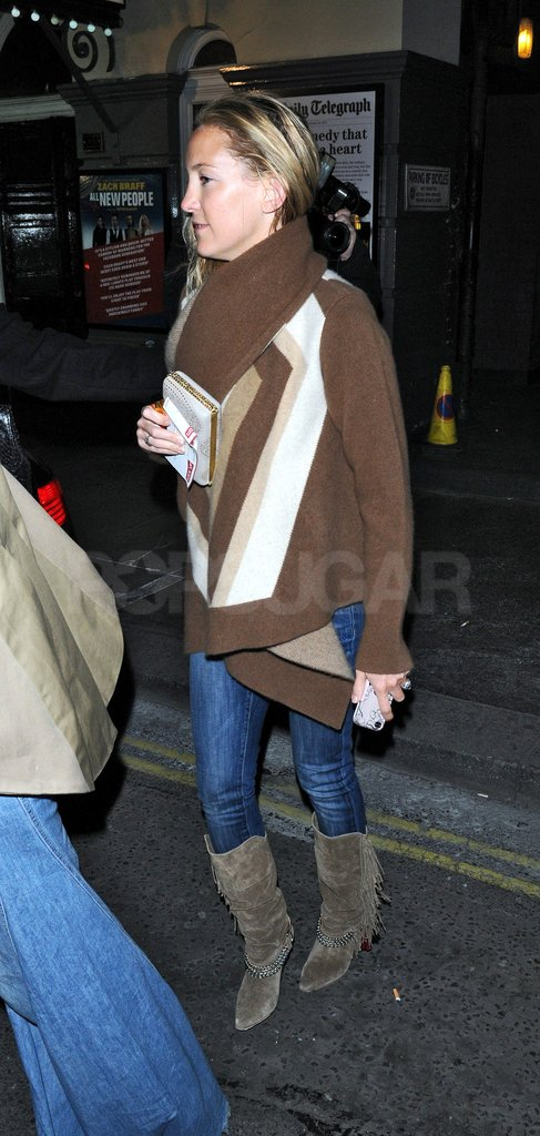 Kate Hudson arrived in a casual sweater and boots.
