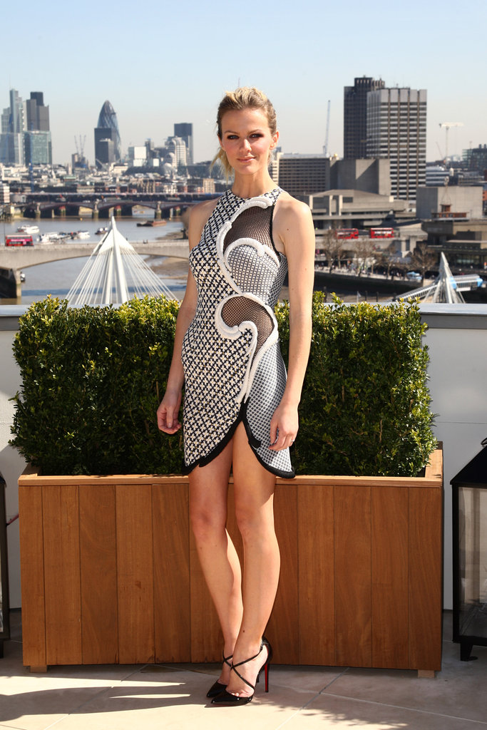 Brooklyn Decker wore a blue and white dress with mesh cutouts for a photocall for Battleship in London.