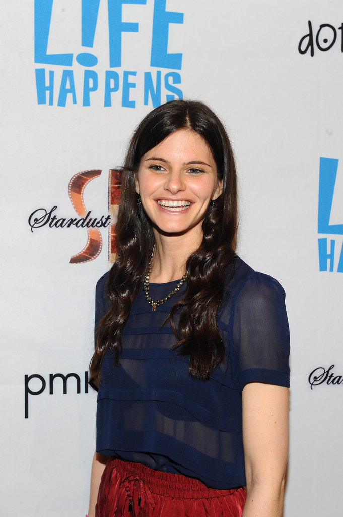 Lindsey Kraft wore a sheer navy blue top and red skirt to the premiere of Life Happens in Century City.